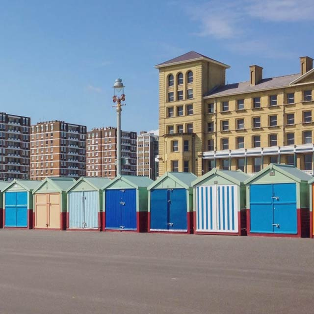 coloured beach huts along the beach