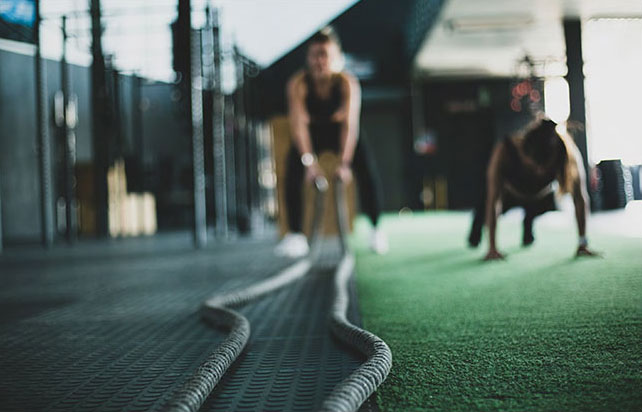 out of focus gym shot with two women and ropes