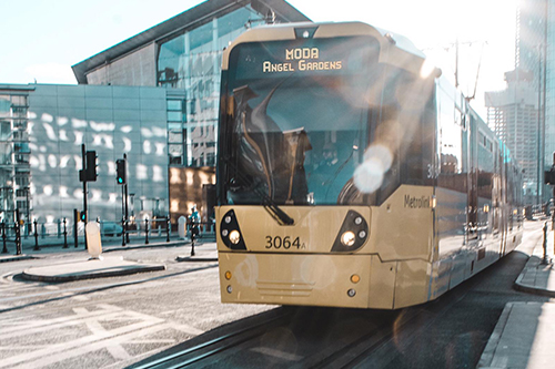 Image of tram and sunshine in Manchester