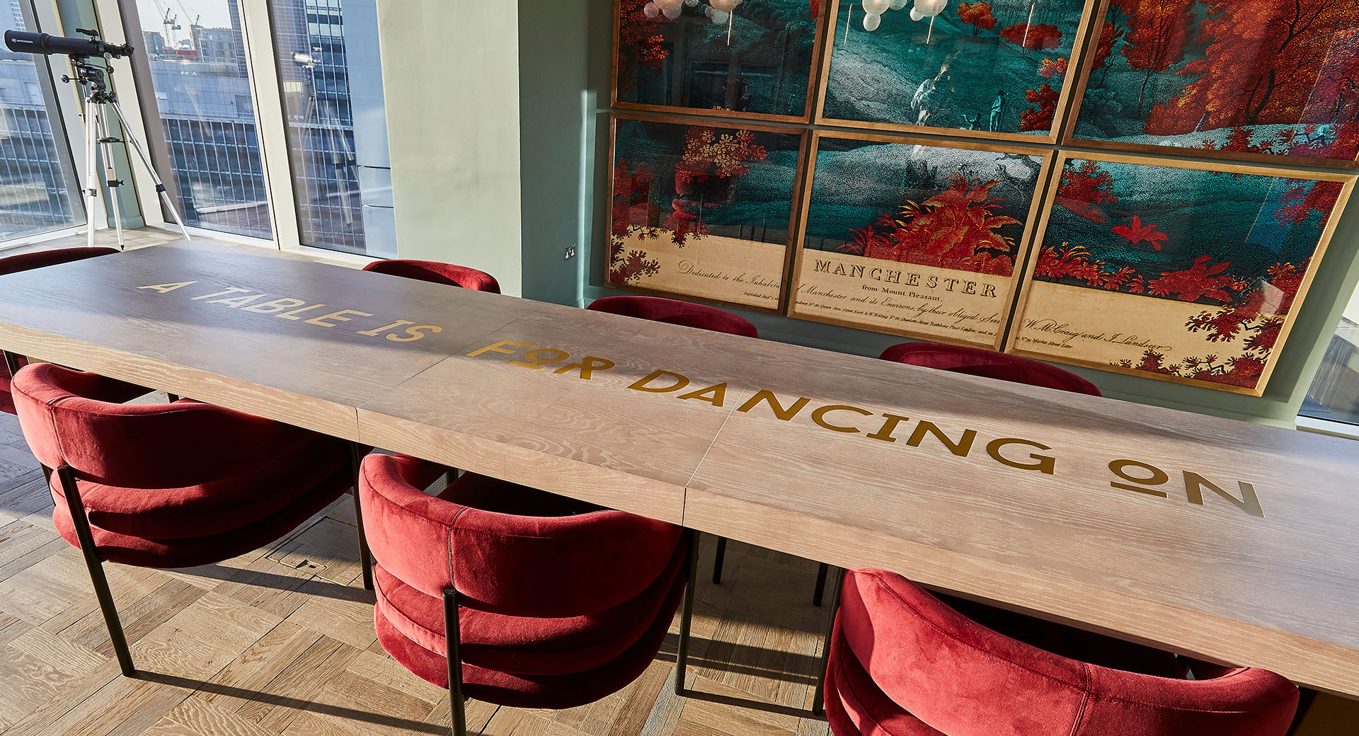 close up of wood tables with table is for dancing quote on table top