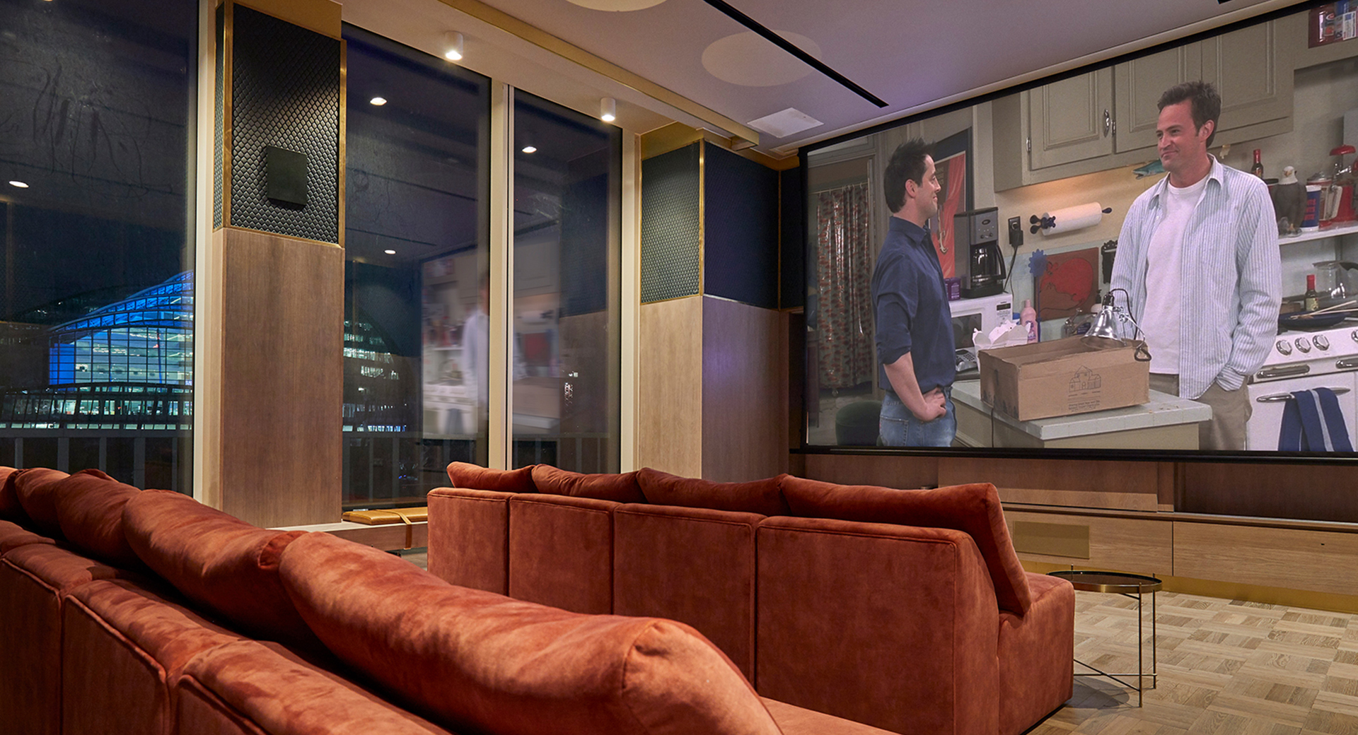 image of sofas and projector screen in media room