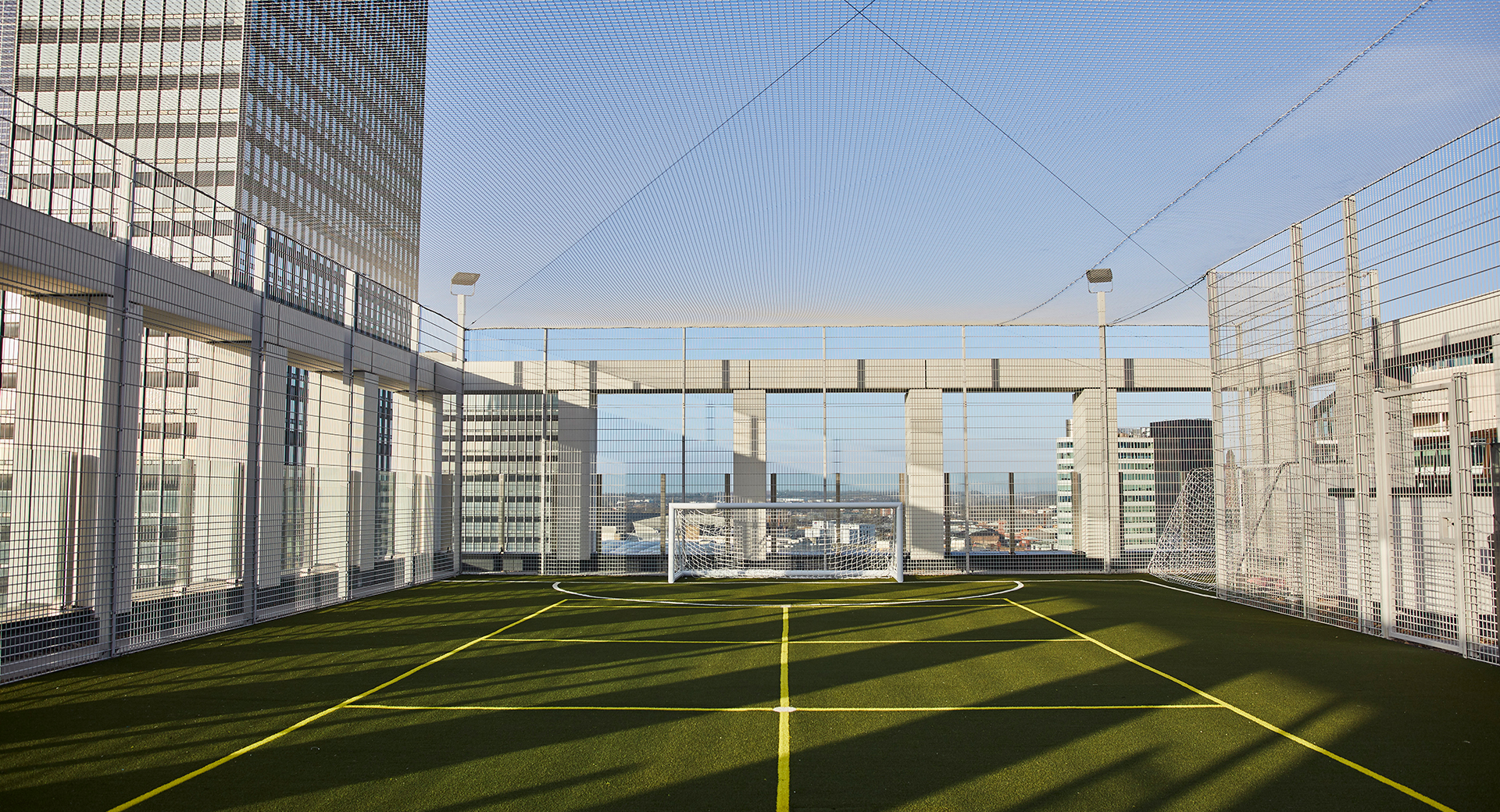 rooftop sports pitch with goals