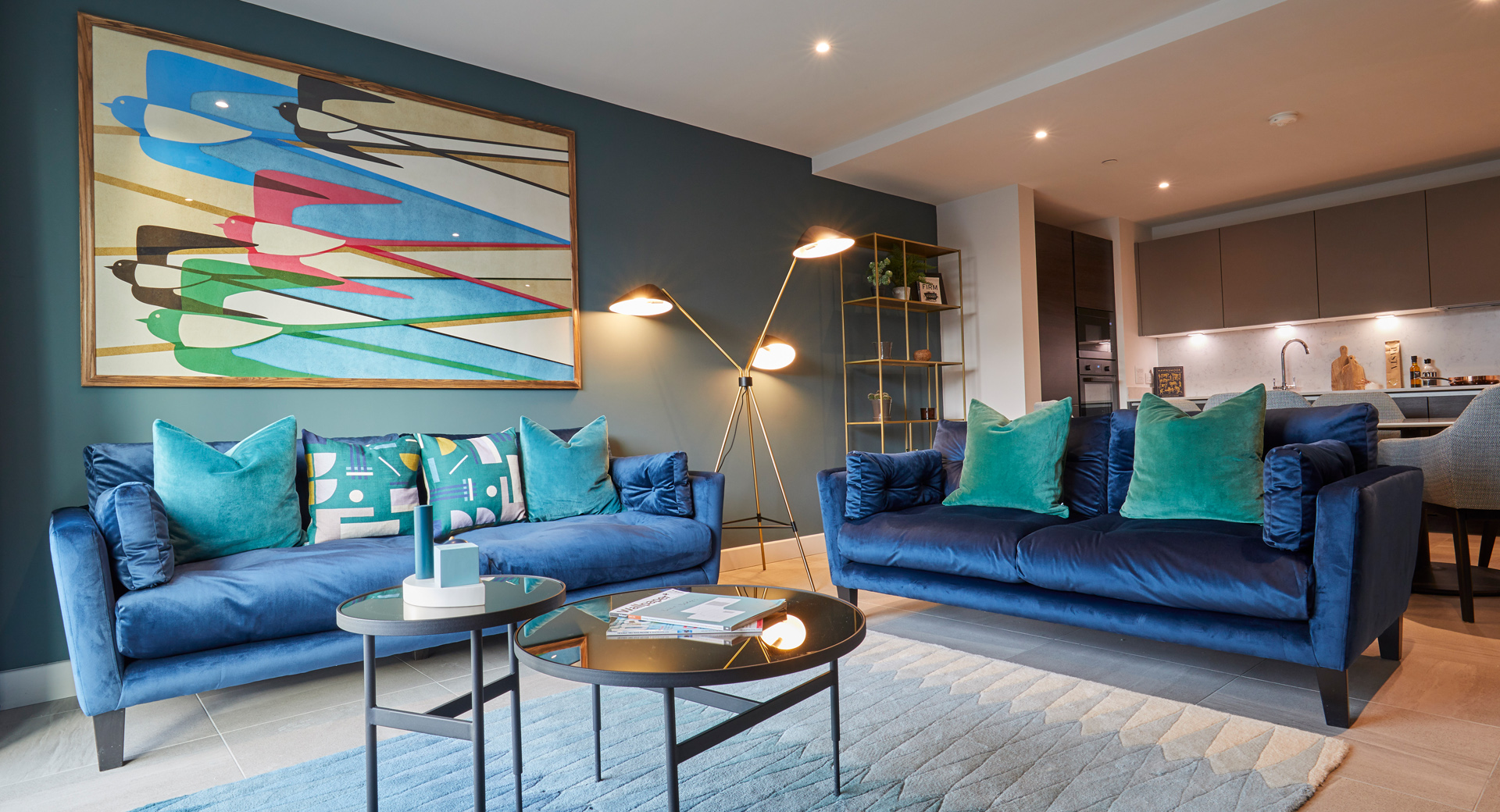 stylish open plan apartment with dark green wall and blue sofa