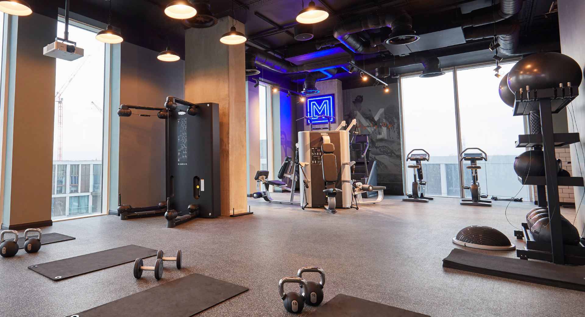 Gym studio area with kettlebells, mats and gym equipment