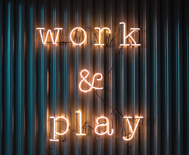 neon sign saying work and play