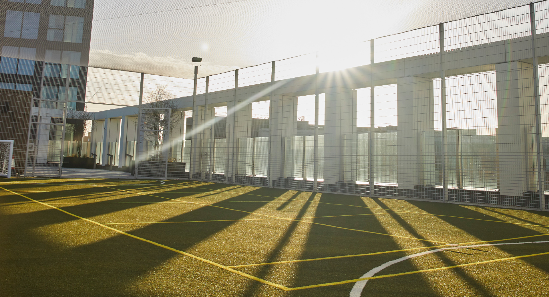Rooftop sports pitch with goals view of building