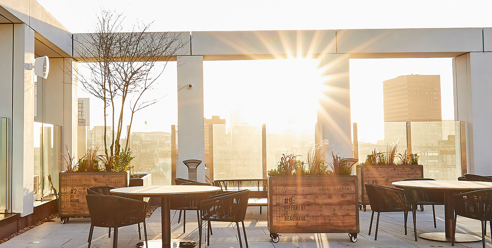 rooftop terrace with wooden seating and wooden furniture