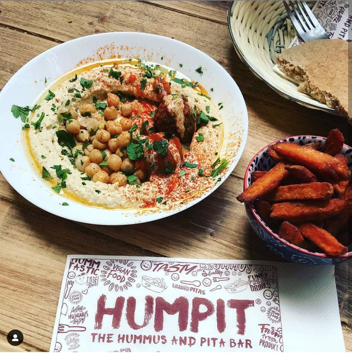 bowl of hummus and sweet potato fries