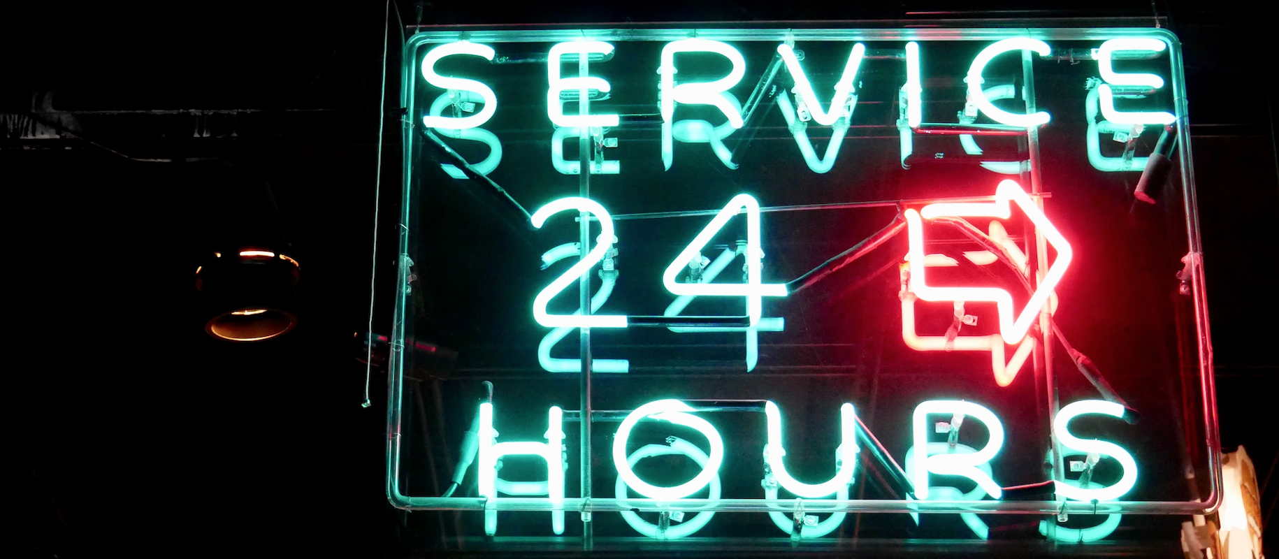 neon sign saying service 24 hours