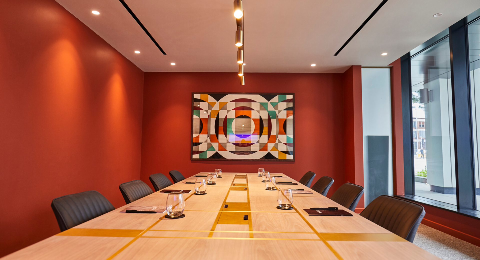 Meeting room with large table and artwork