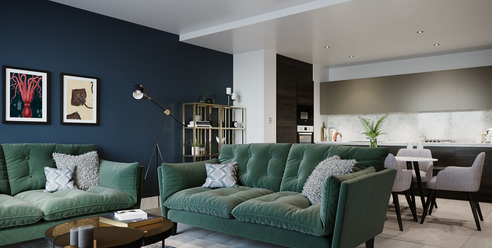 Living space with green sofas, artwork and open plan kitchen in the background